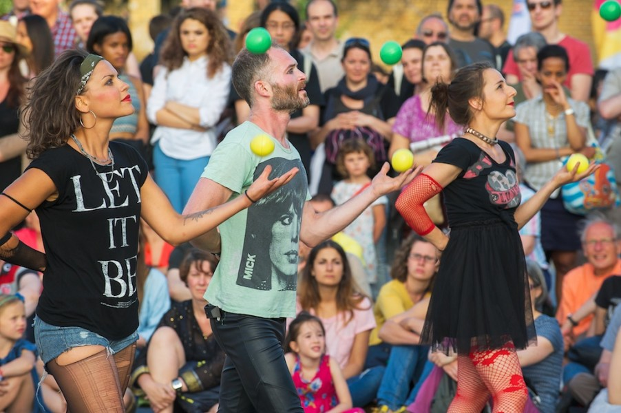 Image of Jugglers perform to crowds at outdoor event