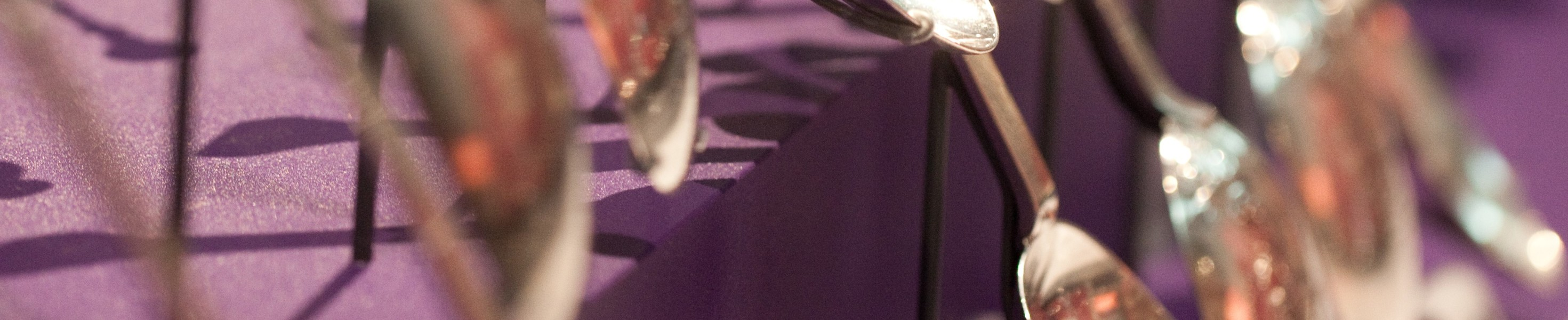 Image of Displayed silver teaspoon - cropped to abstract banner