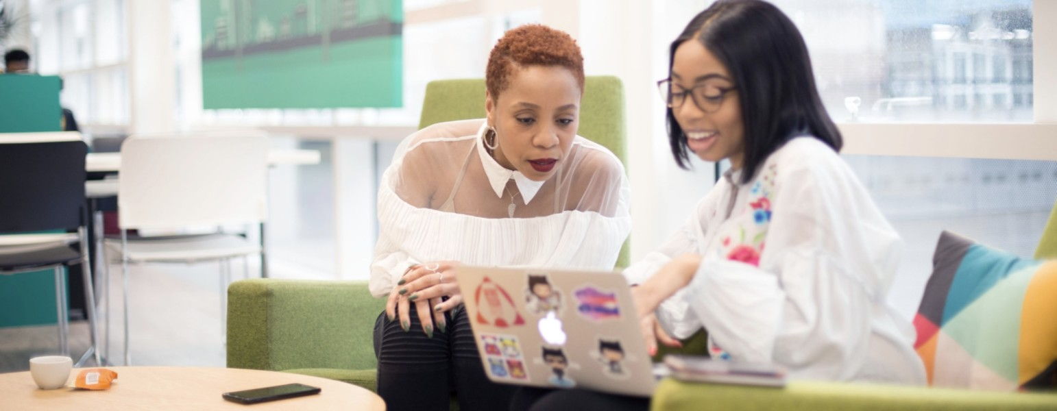 Image of Women looking at a laptop, stock image