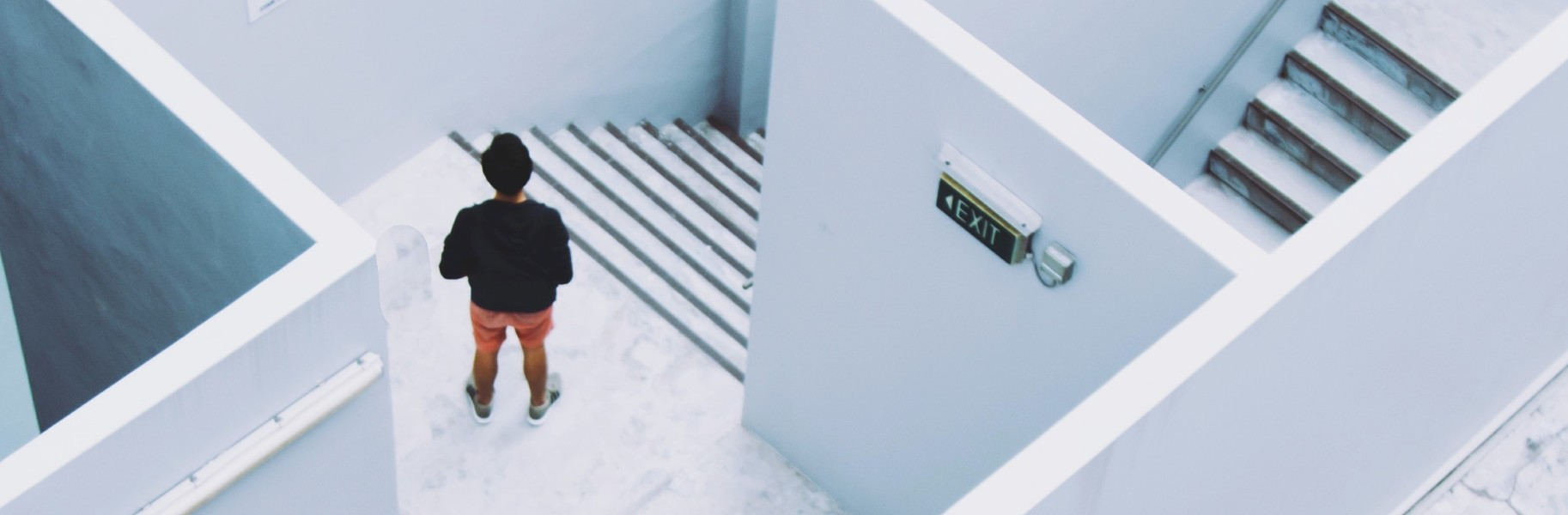Image of Figure in white stairwell from above
