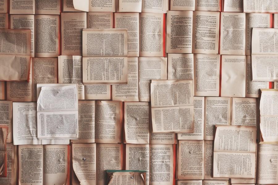 Image of Open books tiled across the floor