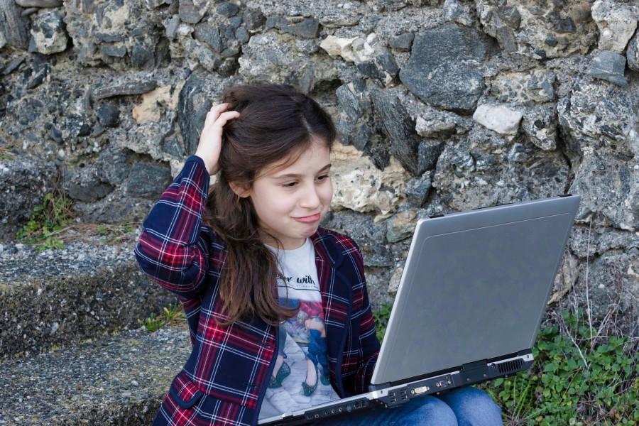 Image of Girl on Laptop Computer Outside.jpg